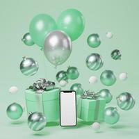 bespotten slimme telefoon met groene kerst ornament achtergrond foto