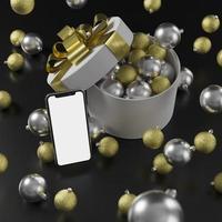 bespotten slimme telefoon met zwarte en gouden kerst ornament achtergrond foto