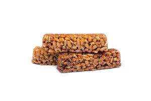 zaden in karamel, geïsoleerd op een witte achtergrond foto