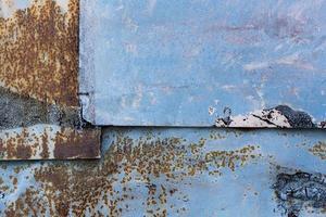 roestige bekraste blauwe muur foto