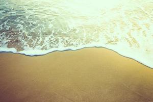 zwaai naar het strand foto