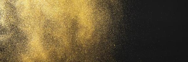 gouden glitter zwarte achtergrond foto