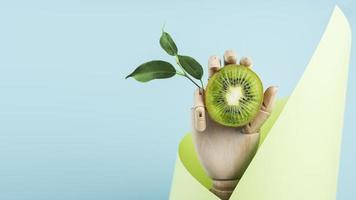 hand met kiwi op blauwe achtergrond foto