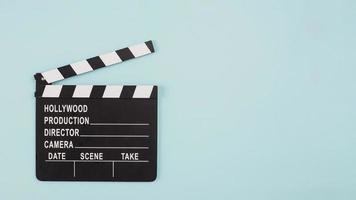 Filmklapper met copyspace op munt achtergrond foto