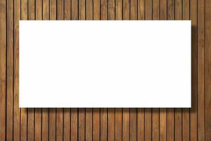 blanco papier textuur op vintage bruin hout achtergrond foto