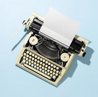 klassieke typemachine op blauwe achtergrond foto