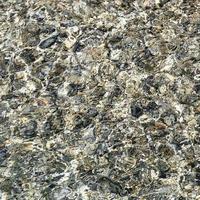 rotsen in de oceaan foto