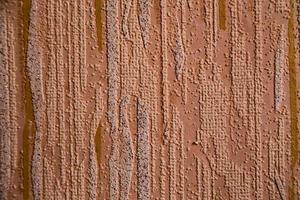 close-up van gestructureerde oranje wallpaper achtergrond foto