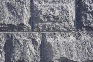 de muur van granieten blokken is als een achtergrond foto
