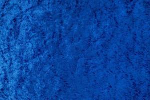 donkerblauwe glanzende effen fluwelen stof als achtergrond foto