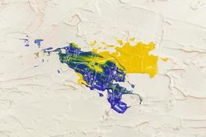 verf penseelstreek textuur achtergrond met geel en blauw foto