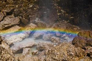 regenboog in de val travenanzes watervallen foto