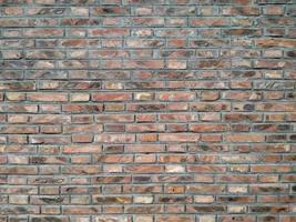 rood oranje grijs oud bakstenen muurpatroon foto