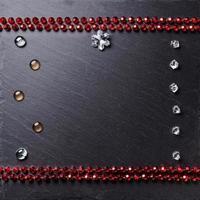 zwart bord omlijst met decoraties, ruimte voor een tekst, bovenaanzicht. foto