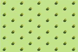 minimaal repetitief patroon gemaakt van groene appels op groene achtergrond foto