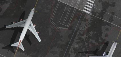 bovenaanzicht vanuit de lucht van het vliegtuig op de luchthaven foto