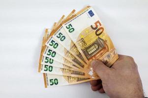 hand van man met 50 euro fan foto
