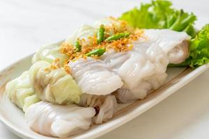 kow griep pag mor of varkensvlees gestoomde rijstpakketten parcel foto