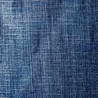 rechthoek van armoedig blauw denim, achtergrond van getextureerd jeansmateriaal foto