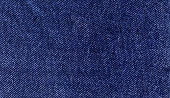 blauwe denim rechthoek, achtergrond van getextureerd jeansmateriaal foto