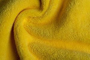 gele stof textuur achtergrond, abstract, close-up textuur van doek foto