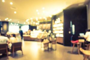 abstracte vervaging en onscherpe restaurant en koffie interieur foto