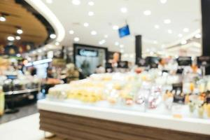 abstract vervagen supermarkt in winkelcentrum en winkel and foto