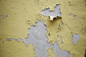 afbladderende geschilderde muur foto