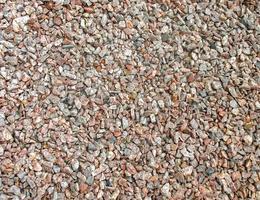 oppervlak, gelijkmatig bedekt met grind. achtergrond afbeelding. foto