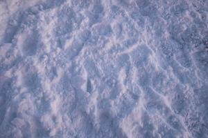 besneeuwde textuur in het winterseizoen foto