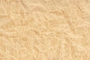verfrommeld kraftpapier textuur achtergrond. lichtbruine kleur foto