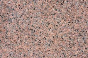natuurlijke achtergrond van rood behandeld graniet. foto