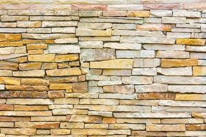 slordige of ongelijke bakstenen muur, textuurachtergrond foto