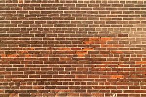 bruine bakstenen muur textuur achtergrond. foto