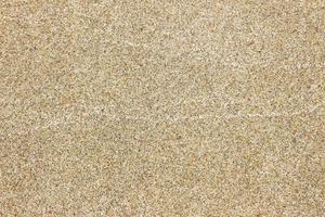zand textuur achtergrond op het strand foto