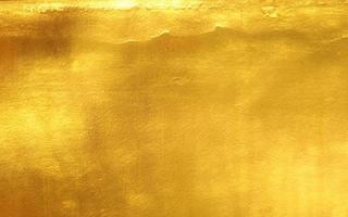 glanzende gele bladgoudfolietextuur foto