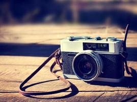 vintage camera houten achtergrond foto