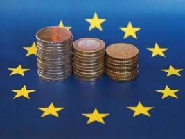 euromunten, europese unie, over vlag foto