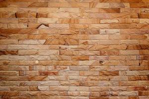 bruine bakstenen muur voor achtergrond foto