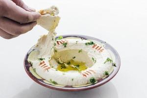 Midden-Oosterse hummus kikkererwten dip meze mezze starter snack food set foto