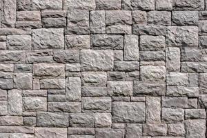 naadloze stenen muur textuur achtergrond. foto