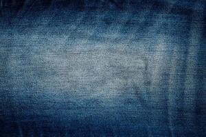de textuur van blauwe jeansstijl grunge foto