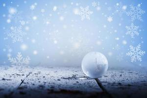 wereldbol met sneeuwvlokkerstmis foto