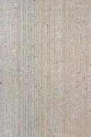 lichtroze textuur van de reliëfmuur foto