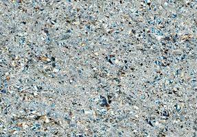 grijze aluminium textuur achtergrond met kleurreflecties foto