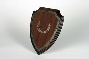 diverse houten en metalen platen voor kampioenschappen en wedstrijden foto