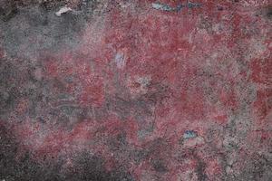 oud gepleisterd oppervlak bordeaux en grijs foto