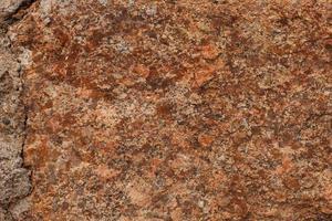 fragment van ruwe bruine steen foto
