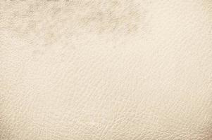 crème kleur leder achtergrondstructuur. close-up behang foto