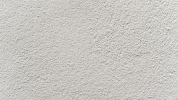 details van de crèmekleurige cementmuur voor de achtergrond. foto